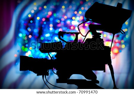 silhouette of a professional television camera on tripod