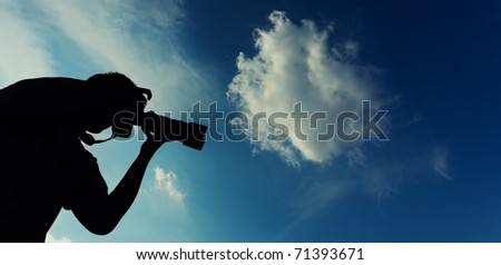 silhouette of a professionell photographer - stock photo