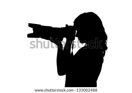 silhouette of a sexy girl taking pictures with a camera