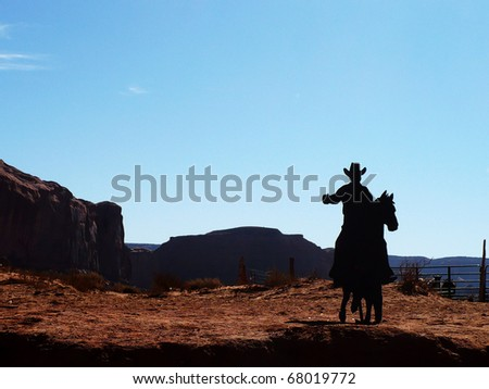 Silhouette of a sign of a cowboy riding a horse