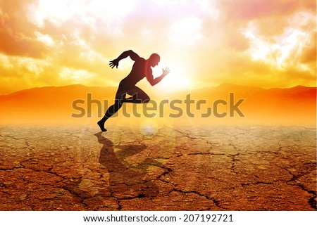 Silhouette of a sprinter running on drought land #207192721