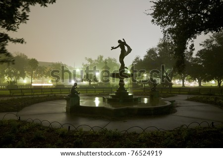 Silhouette of a Statue and Fountain at night in Audubon Park, New Orleans, Louisiana.