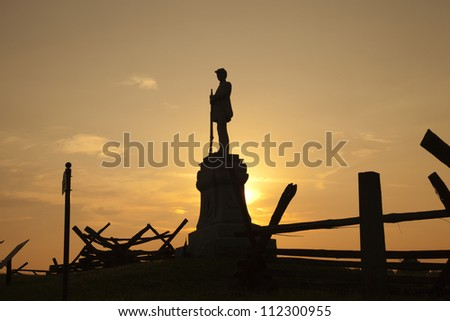 Silhouette of a statue in honor of the 130th Pennsylvania Volunteer Infantry at Bloody Lane in the Antietam (Sharpsburg) National Battlefield, Maryland, USA