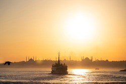 Silhouette of a Streamboat when sunset time at Istanbul Kadikoy