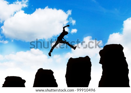 Silhouette of a successful businessman jumping off obstacles to reach the top of his carrier.