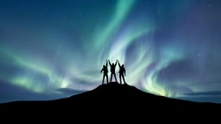 Silhouette of a team at the northen light background. Sport and active life concept and idea of team
