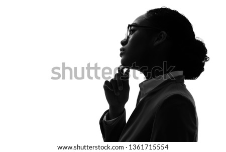 Silhouette of a thinking black woman.