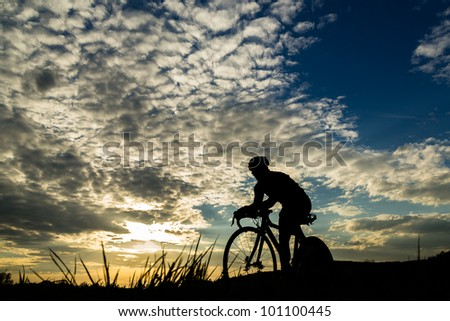 silhouette of a triathlete in cycling