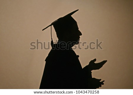 Silhouette of a university professor during the opening ceremony of the academic year