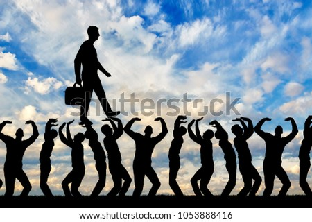 Silhouette of a walking selfish and narcissistic man on the hands of the crowd. The concept of selfishness and narcissistic personality Stock photo ©