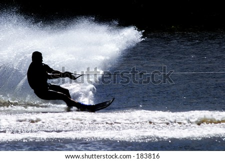 Silhouette of a water skier in action...