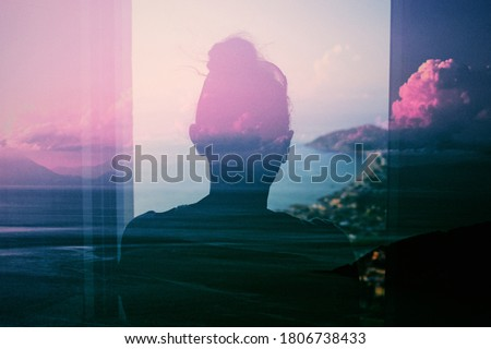 Silhouette of a Woman at Window during Twilight