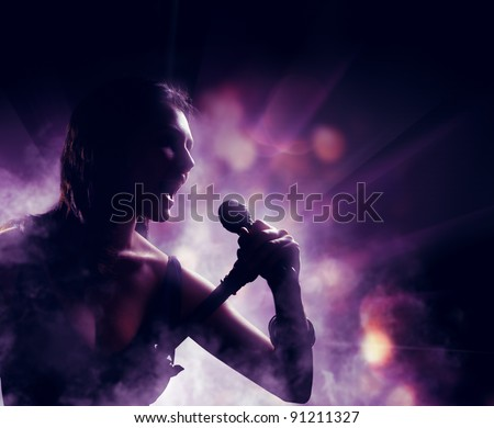 silhouette of a woman on a background of lights