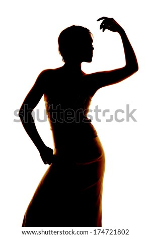 Silhouette of a woman posing in a dress.