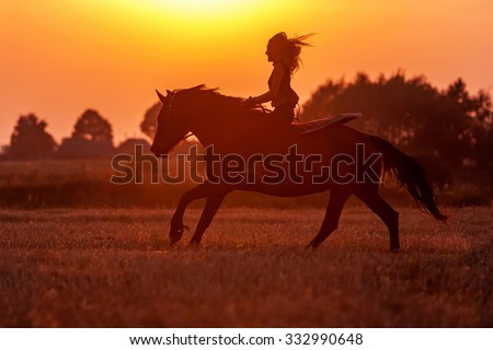 Silhouette of a woman riding a horse.