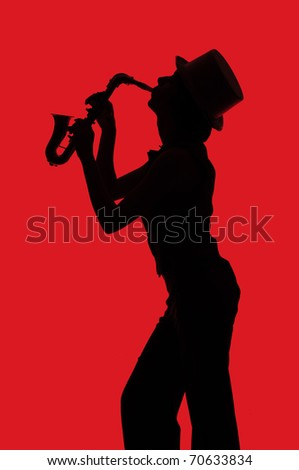 Silhouette of a woman with saxophone on red background