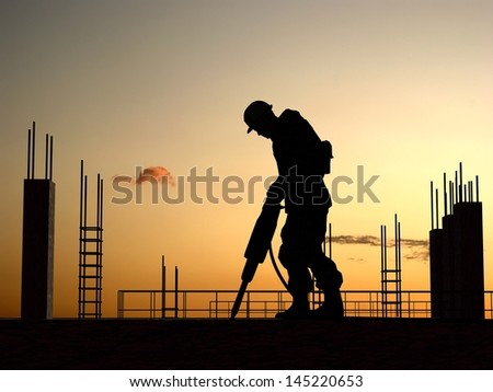 Silhouette of a worker on a background sky