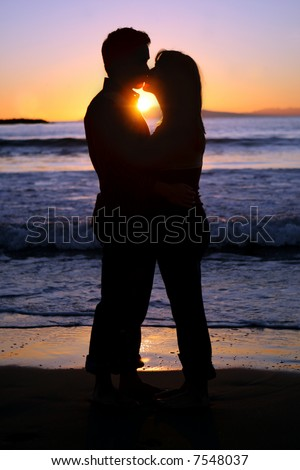 couple kissing silhouette image. a young couple kissing at