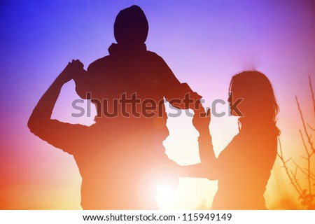 silhouette of a young family