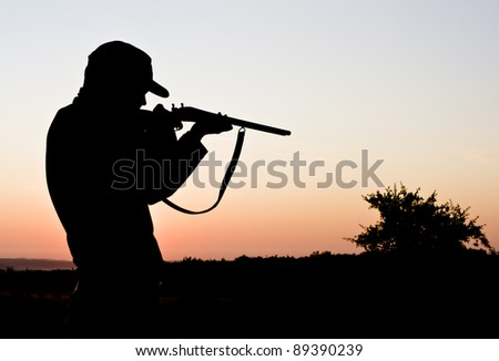 Silhouette of a young man shooting