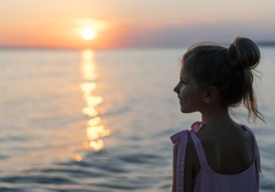 Silhouette of adorable little girl on a beach at sunset. Young girl on the beach at sunset. child looking at sunset at sea. girl on the beach, tourist near the sea, sunset in the ocean