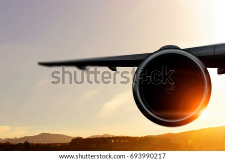 Silhouette of airplane in sky. Mixed media #693990217