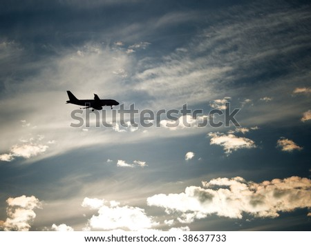 Silhouette of an airplane against interesting blue sky