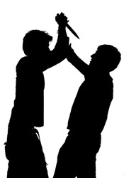 Silhouette of an attack with a knife depicting violence isolated against white background