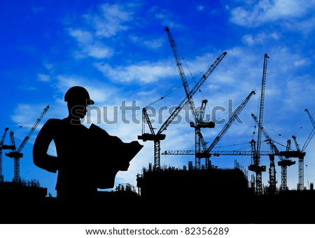 silhouette of an engineer working on construction site at day time