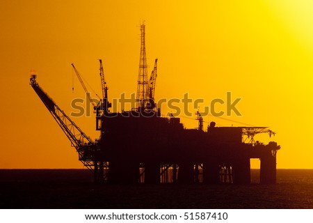 silhouette of an offshore oil rig