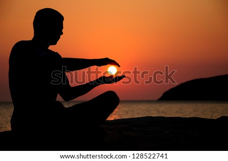 silhouette of an young man on sunrise