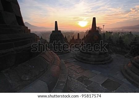 Silhouette of Ancient stupa Borobudur Temple, sunrise in Yogyakarta, Java, Indonesia.