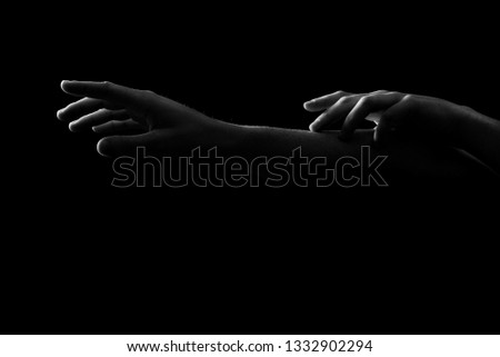 Silhouette of arm on black background #1332902294