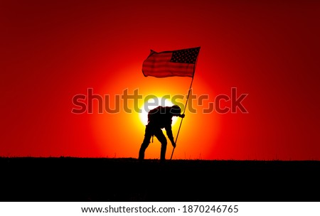 Silhouette of army soldier, United States of America infantryman sticking into ground flagpole with waving USA national flag. Soldiers heroism and victory, military honor and memory of fallen warriors Stock photo ©
