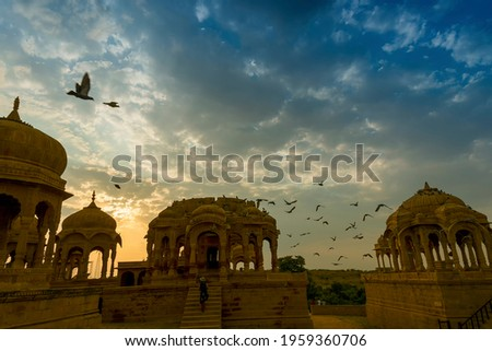 Silhouette of Bada Bagh or Barabagh, means Big Garden, is a garden complex in Jaisalmer, Rajasthan, India, for Royal cenotaphs of Maharajas means Kings of Jaisalmer state. Tourist attraction. Zdjęcia stock ©