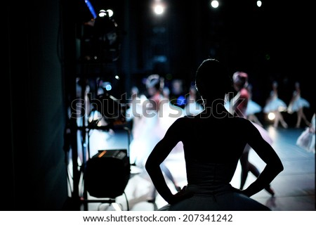 Silhouette of ballerina on background of ballet performance, backstage