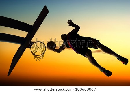 Silhouette of basketball against the sky