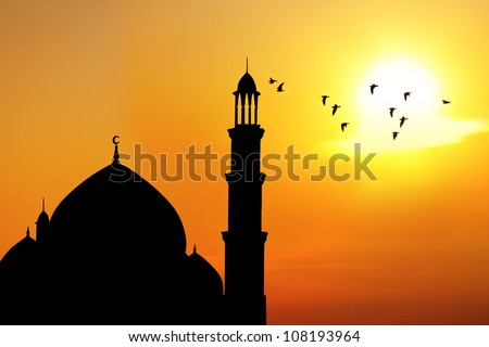 Silhouette of beautiful dome and minaret of mosque. shot at sunset