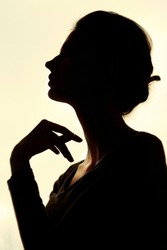 Silhouette of beautiful young woman with a beautiful hairdo. Black and white-Image