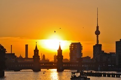 Silhouette of Berlin in the sunset - with the Oberbaum bridge, television tower and other landmarks of Berlin, Germany.