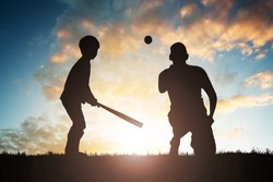 Silhouette Of Boy Playing Baseball With His Father At Sunset