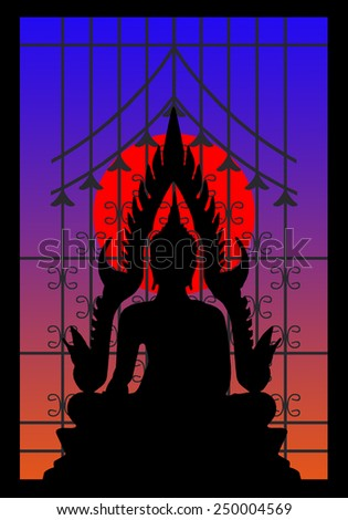 Silhouette of buddha and wrought iron window on the sunset