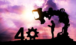 Silhouette of business man command automation robot arm machine technology , industry 4.0 , artificial intelligence trend concept. Sunrise twilight background.