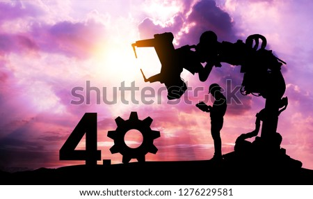 Silhouette of business man command automation robot arm machine technology , industry 4.0 , artificial intelligence trend concept. Sunrise twilight background. #1276229581
