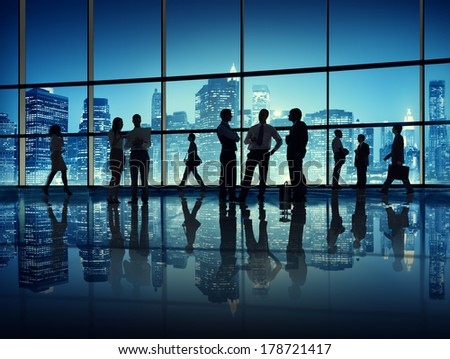 Silhouette of Business People in Office with City Lights