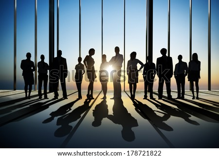 Silhouette of Business People Posing by Window