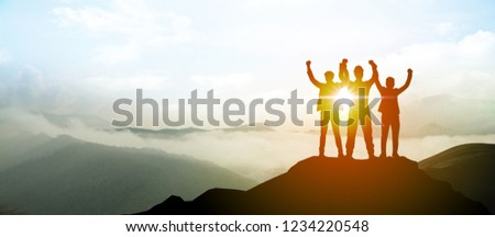 Silhouette of Business team show arm up on top of the mountain. Leadership and success Concept. #1234220548