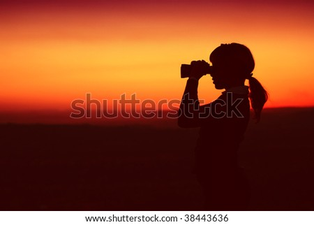 Silhouette of Business Woman with Binoculars Standing on a Hilltop