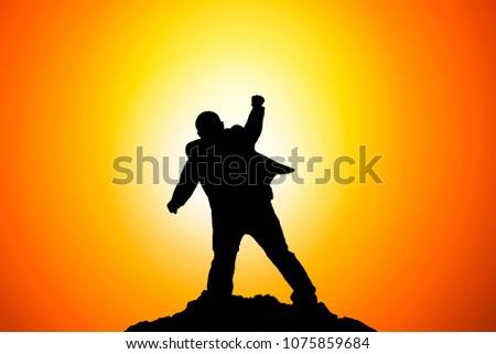 Silhouette of Businessman Celebration Success Happiness on a mountain top. Business, achievement, success, concept #1075859684