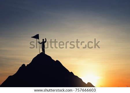 silhouette of businessman hold...